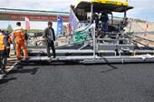 名稱:福格勒攤鋪機在施工現場 人氣:3081